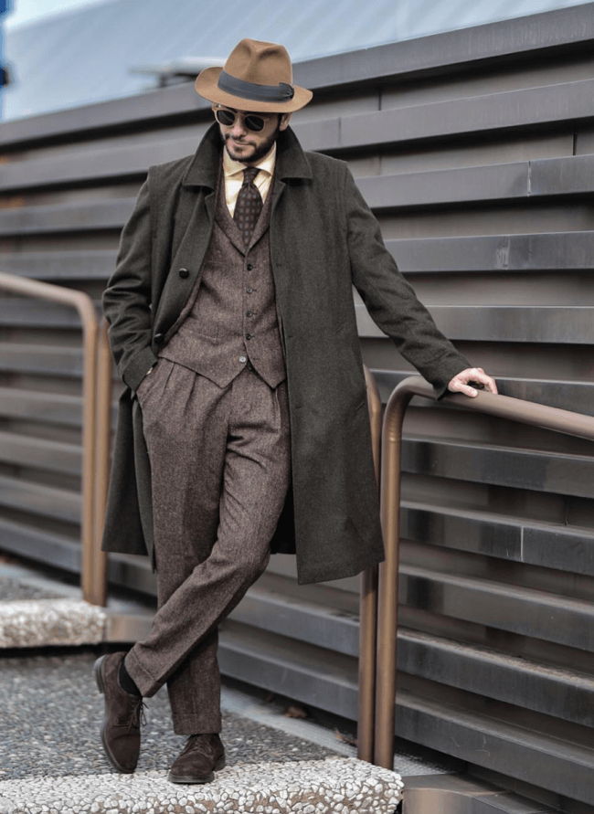 fedora hat, long coat and suit
