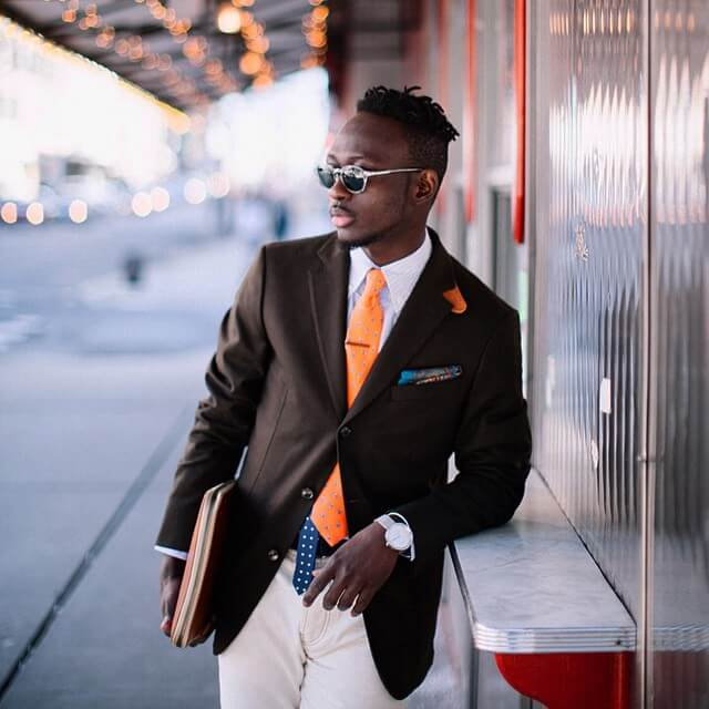 orange and burgundy ties and pocket squares