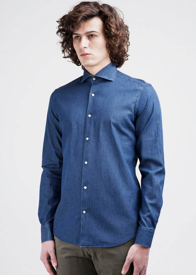 Man in a dark blue denim dress shirt