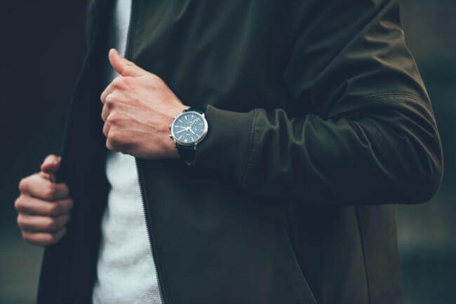 man with wristwatch and jacket